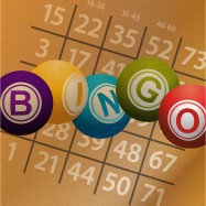 Bingo Balls and Numbers from a Bingo Card on Brown paper Background